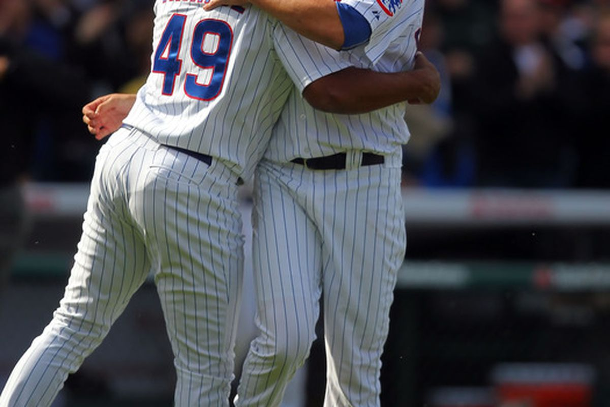 Chicago, IL, USA; Chicago Cubs relief pitcher Carlos Marmol is congratulated for picking up a save by relief pitcher Jeff Samardzija against the Washington Nationals at Wrigley Field. The Cubs won 4-3. Credit: Dennis Wierzbicki-US PRESSWIRE