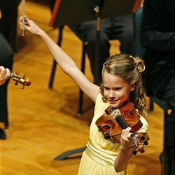Aubree Oliverson plays Kabalevsky's Concerto in C Major. op. 48 during the 50th anniversary Salute to Youth concert Tuesday in Salt Lake City.