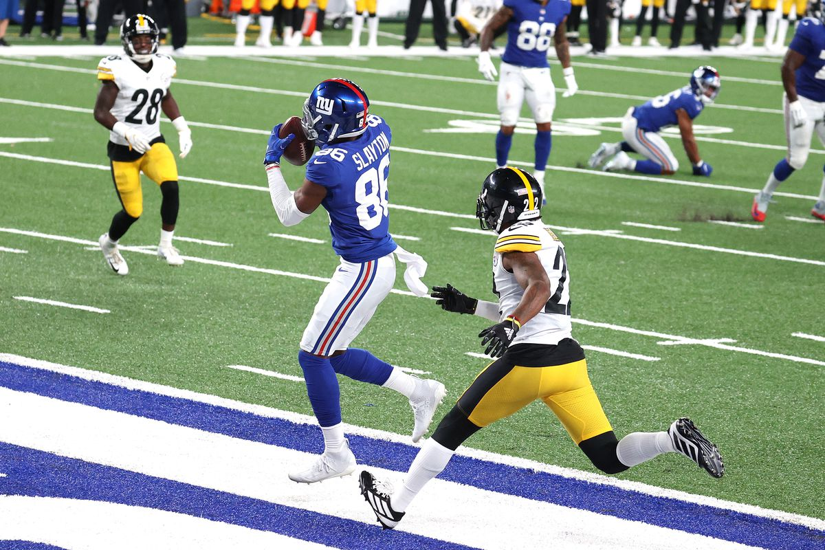 Darius Slayton of the New York Giants catches a seven yard touchdown pass against Steven Nelson of the Pittsburgh Steelers during the fourth quarter in the game at MetLife Stadium on September 14, 2020 in East Rutherford, New Jersey.