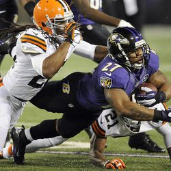 Baltimore Ravens running back Ray Rice (27) is stopped by Cleveland Browns free safety Usama Young (28) and cornerback Dimitri Patterson (21) during the first half of an NFL football game in Baltimore, Thursday, Sept. 27, 2012.