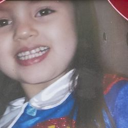 Gialanni Ayala was one of 10 children who died in a fire early Sunday in the 2200 block of South Sacramento Avenue in Little Village. | Sun-Times photo by Ashlee Rezin of family photo on display at memorial