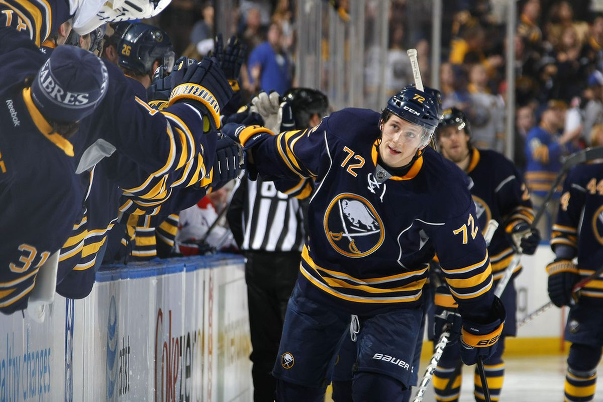 BUFFALO, NY - NOVEMBER 26:  Luke Adam #72 of the Buffalo Sabres celebrates his goal against the Washington Capitals during their NHL game at First Niagara Center on November 26, 2011 in Buffalo, New York.  (Photo by Dave Sandford Getty Images)