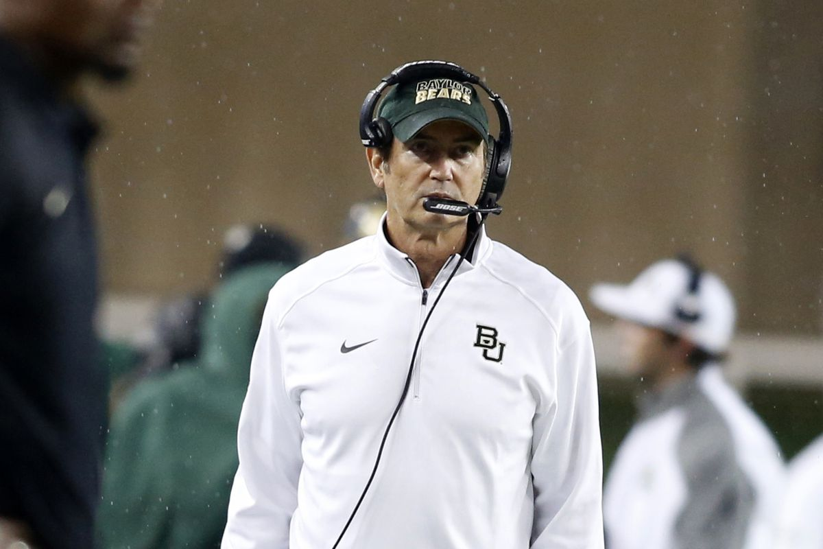Art Briles stares down the committee. Much more suave than I would.