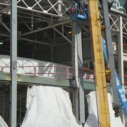 12:03 p.m. The beam is actually a piece being used to cover the front of one of the existing support beams in front of the ballpark -