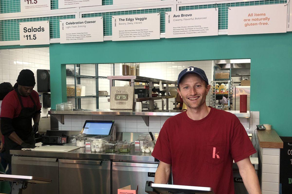 A man behind a counter