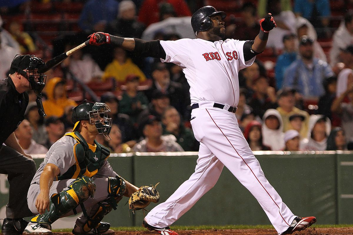 BOSTON, MA - AUGUST 27:  David Ortiz #34 of the Boston Red Sox hits a home run against the Oakland Athletics at Fenway Park August 27, 2011 in Boston, Massachusetts. (Photo by Jim Rogash/Getty Images)