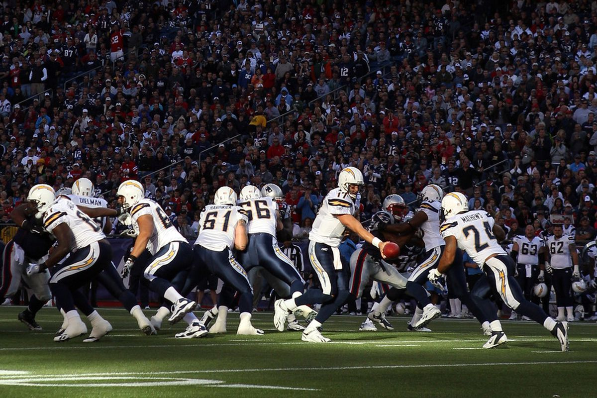 FOXBORO, MA:   Philip Rivers #17 of the San Diego Chargers hands the ball off to   Ryan Mathews #24 in the second quarter against the New England Patriots  at Gillette Stadium in Foxboro, Massachusetts.  (Photo by Elsa/Getty Images)