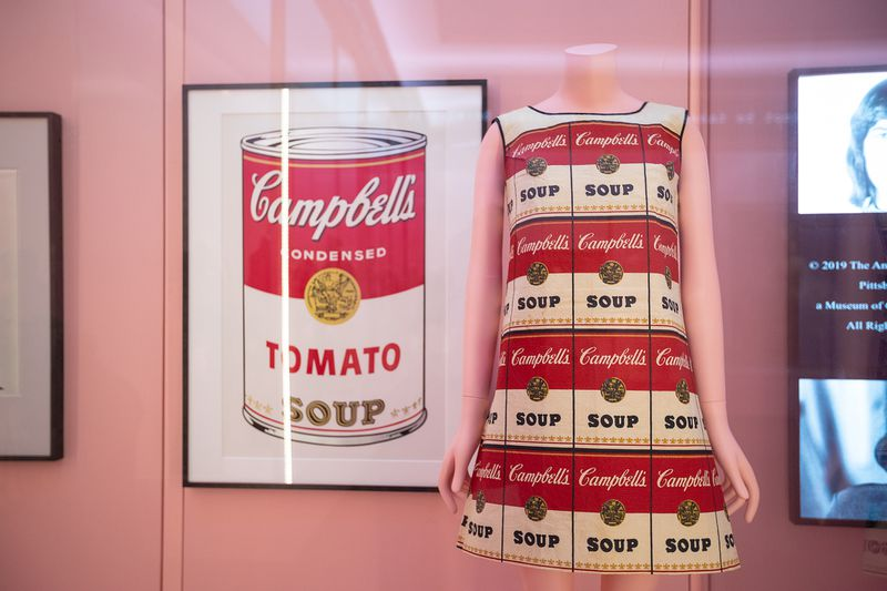 A print of Warhol's Campbell's tomato soup, and a dress with the same print repeated across it.