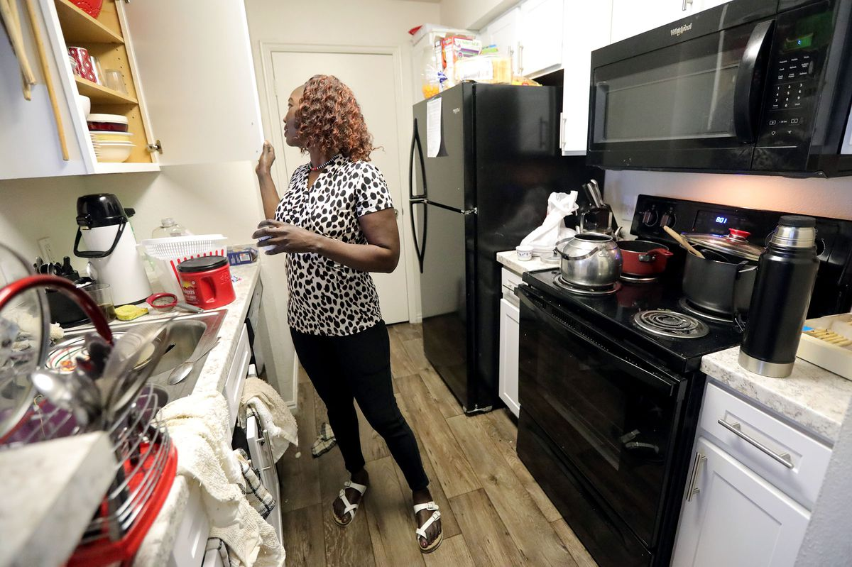 Tabitha Kwayge, a Sudanese refugee, makes coffee in her apartment in Midvale on Wednesday, Sept. 15, 2021. Kwayge is looking for another place for her family to live as the $1,500 monthly rent is too expensive.