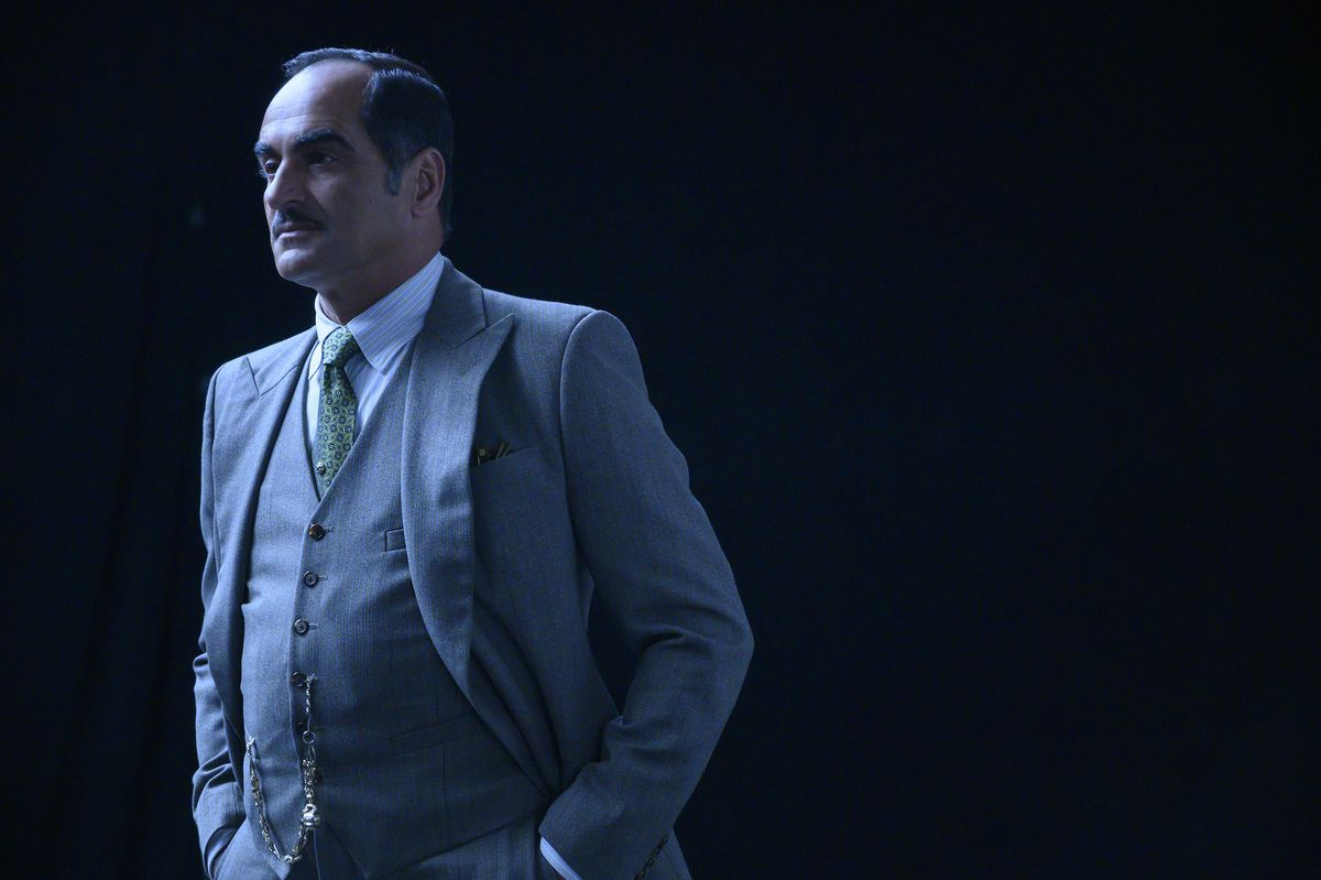A well dressed Amahl Farouk (Navid Negahban) standing in a black void in the series finale of Legion