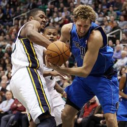 Derrick Favors of the Utah Jazz, left, and Dirk Nowitzki of the Dallas Mavericks fight to control the ball during NBA basketball in Salt Lake City, Monday, Jan. 7, 2013.