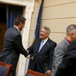 John Valentine, chairman of the Utah State Tax Commission, greets people in the Senate chambers on the first day of the Utah Legislature at the Capitol in Salt Lake City on Monday, Jan. 25, 2016.