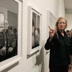 """Annie Leibovitz talks about some of her work during a tour of her exhibition at the Wexner Center for the Arts Friday, Sept. 21, 2012, in Columbus, Ohio. Leibovitz's exhibition features work from her """"Master Set,"""" an authoritative edition of 156 images."""