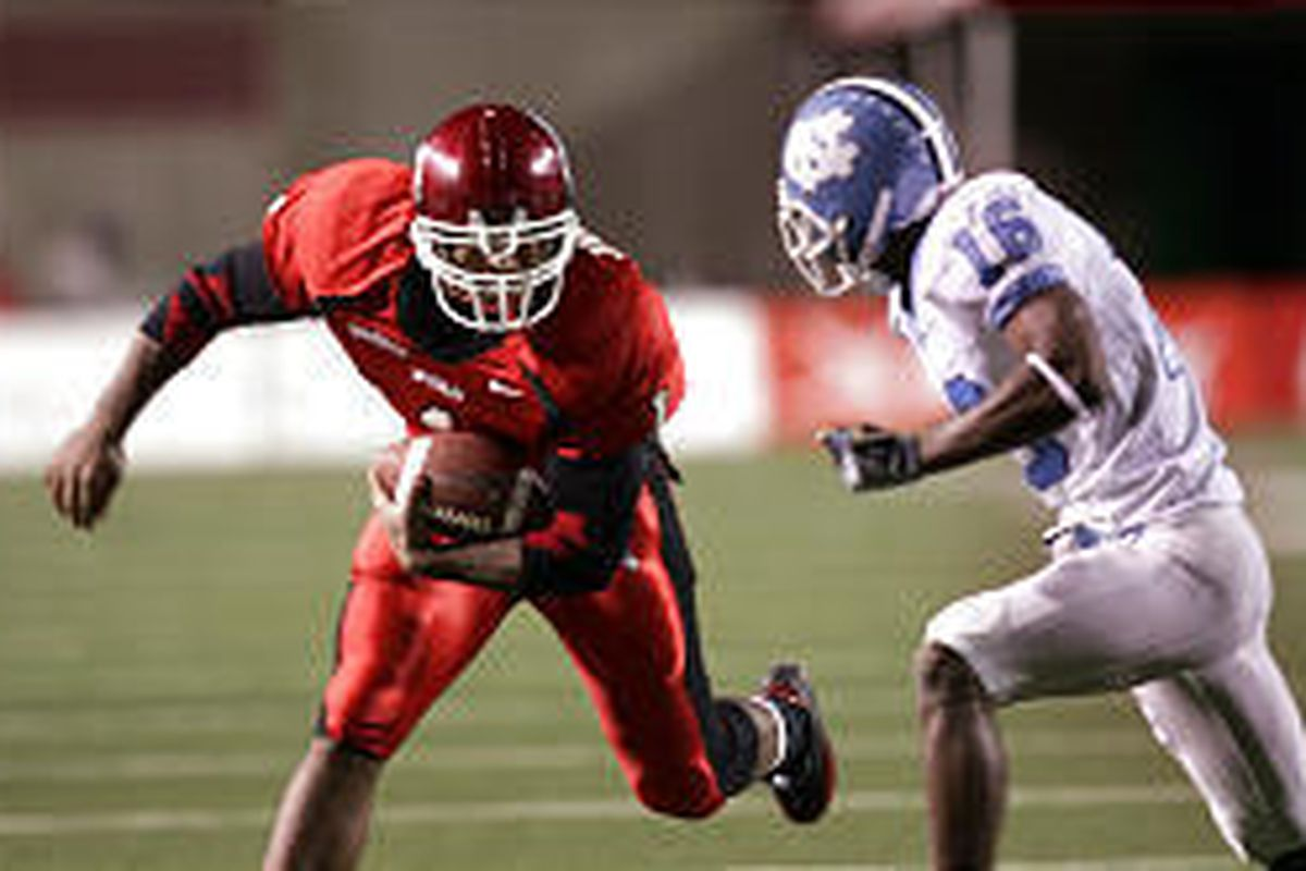 Utah's Marty Johnson looks to get past UNC's Jacoby Watkins in first-half action Saturday at Rice-Eccles Stadium.