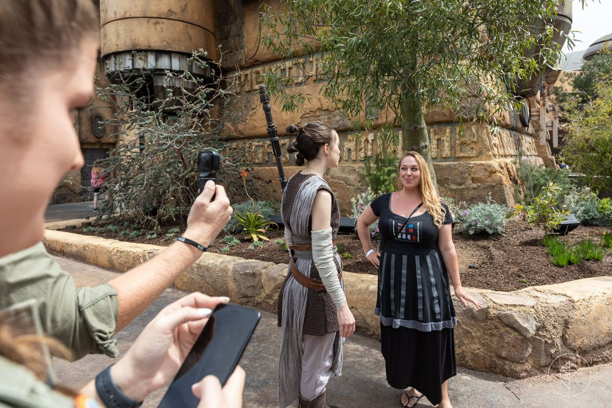 Rey meets with a guest at Star Wars Galaxy's Edge in Disneyland