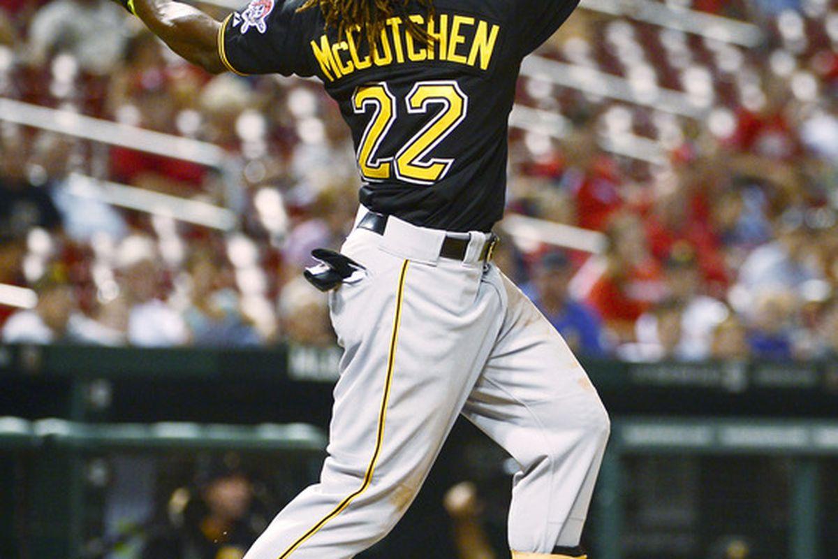 June 29, 2012; St. Louis, MO, USA; Pittsburgh Pirates center fielder Andrew McCutchen (22) hits a 3 run home run against the St. Louis Cardinals at Busch Stadium. The Pirates defeated the Cardinals 14-5. Mandatory Credit: Scott Rovak-US PRESSWIRE
