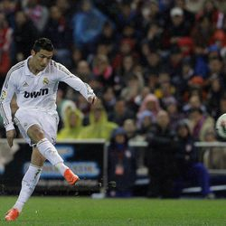 Real Madrid's Cristiano Ronaldo from Portugal scores a goal against Atletico de Madrid during a Spanish La Liga soccer match at the Vicente Calderon stadium, in Madrid, Wednesday, April 11, 2012.