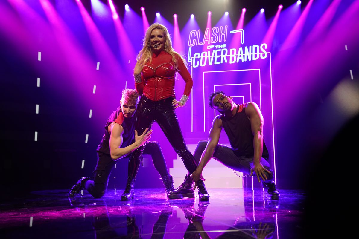 """Katie Murdock performs as Britney Spears on """"Clash of the Cover Bands."""""""