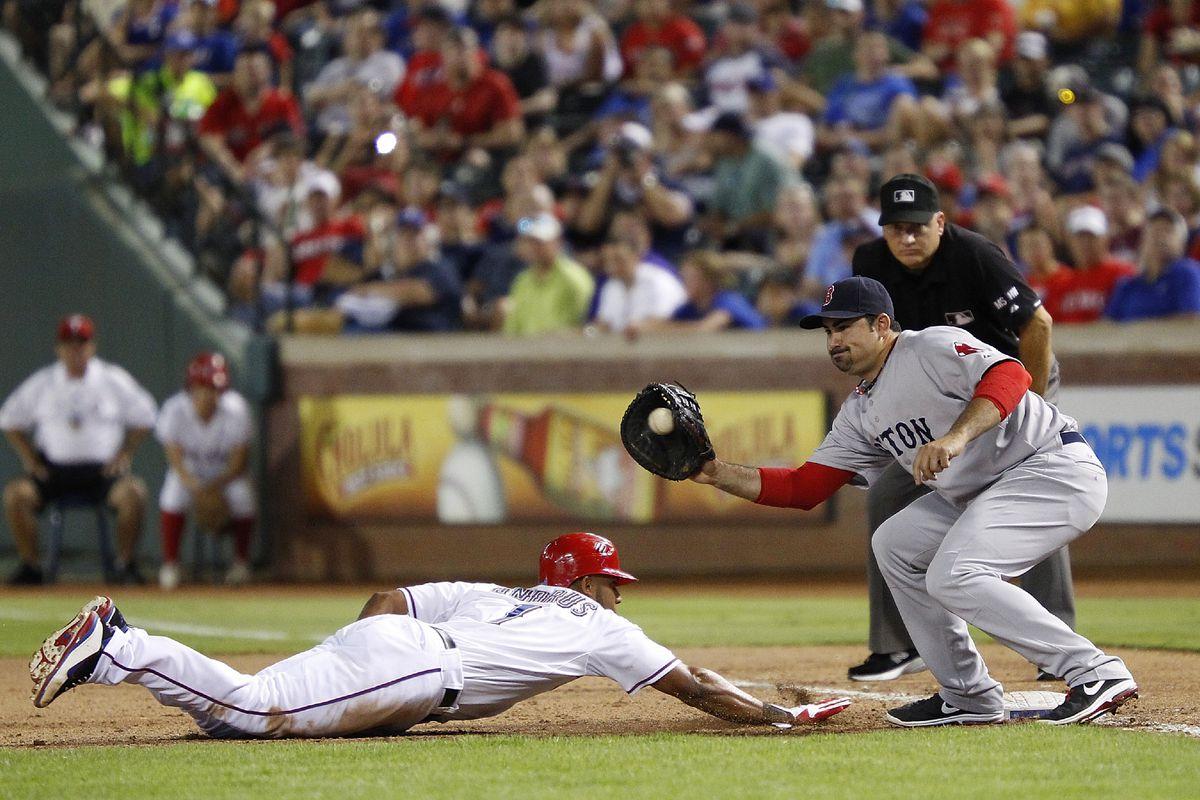 ARLINGTON, TX - JULY 25: Elvis Andrus #1 of the Texas Rangers dives to beat the tag by Adrian Gonzalez #28 of the Boston Red Sox at Rangers Ballpark in Arlington on July 25, 2012 in Arlington, Texas. (Photo by Rick Yeatts/Getty Images)