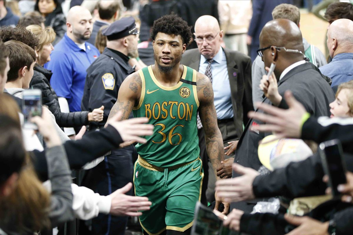 Boston Celtics guard Marcus Smart greets fans after defeating the Golden State Warriors at TD Garden.