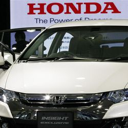 A visitor looks at a car displayed at a showroom at the headquarters of Honda Motor Co. in Tokyo Friday, April 27, 2012. Honda's January-March profit jumped 61 percent as the Japanese automaker sold more cars and motorcycles in a turnaround from a disaster-battered 2011. It forecast record global sales of 4.3 million vehicles for this fiscal year. (AP Photo/Koji Sasahara)