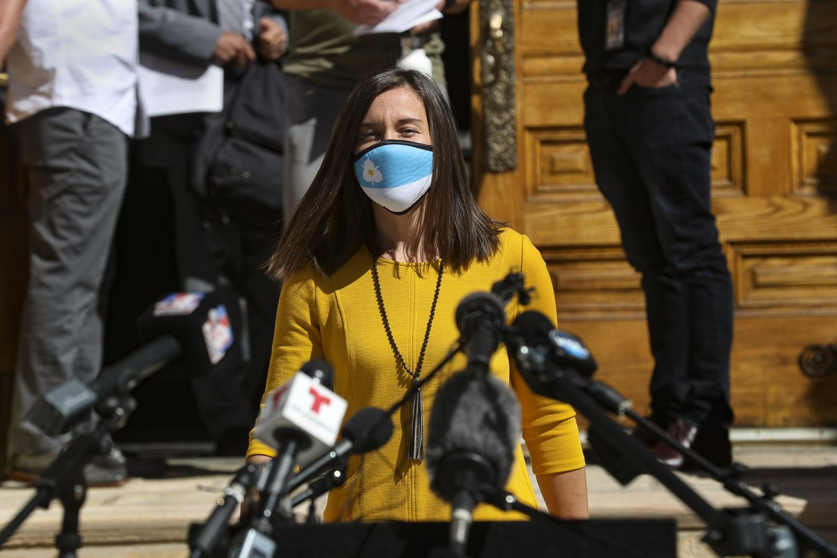 Salt Lake City Mayor Erin Mendenhall smiles under her mask as she walks to the podium for a press conference with members of the City Council and local business owners at the City-County Building on Wednesday, April 7, 2021. Mendenhall announced she is using her office's emergency powers to keep a mask mandate in place after the statewide requirement that face coverings be worn in public to help stop the spread of COVID-19 ends Saturday.