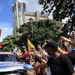 Opposition presidential candidate Henrique Capriles, top, gestures to supporters during a campaign rally in Caracas, Venezuela, Sunday, Sept. 30, 2012. Presidential elections in Venezuela are scheduled for Oct. 7.