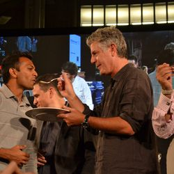 That man paid $1,000 to have Anthony Bourdain feed him iguana.
