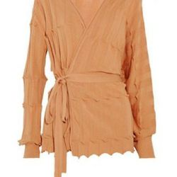 """<a href=""""http://www.theoutnet.com/product/242141"""">Knitted cotton wrap cardigan</a>, $194 (was $485)"""