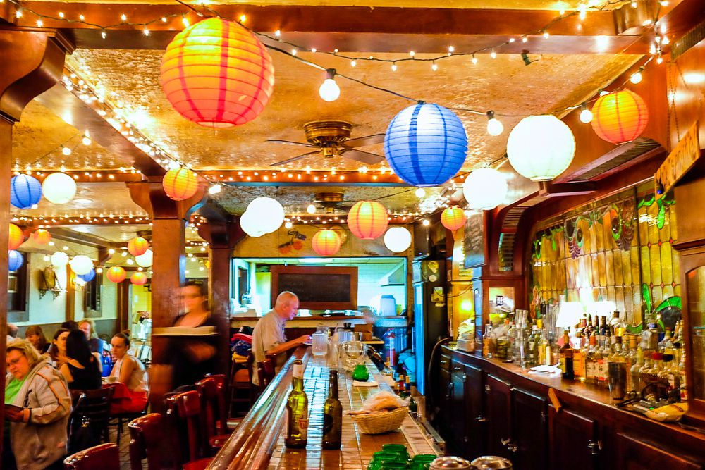 Colorful lanterns light up the ceiling around the wood bar at Polish Village Cafe.