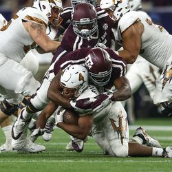 Tackle from Aggie defense
