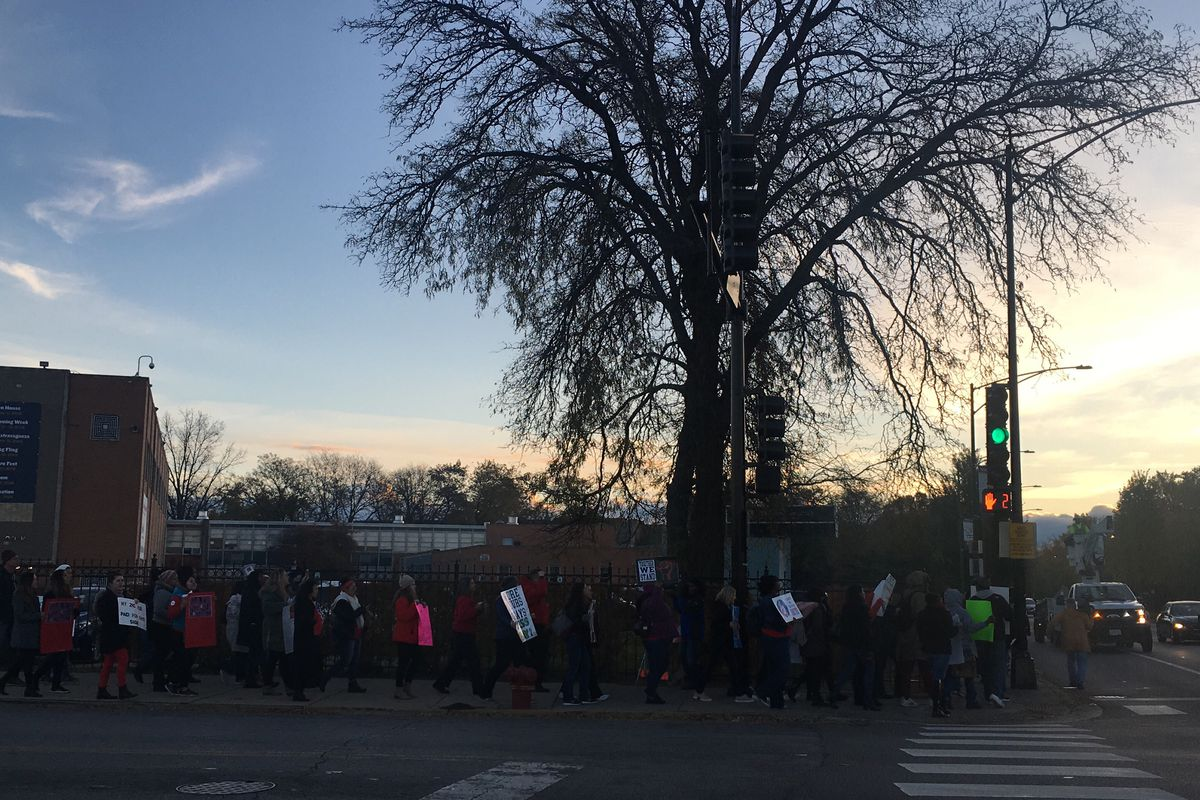 A handful of educators from Chicago International Charter School rallied on an early morning in November ahead of a strike authorization vote.