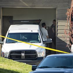 Members of the medical examiner's office respond to a home on the 10200 South block of Jordan Creek Drive in South Jordan where35-year-old Ashley Sorenson was found dead on Monday, April 20, 2020.