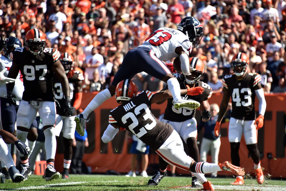 Wide receiver Brandin Cooks #13 of the Houston Texans catches the ball over cornerback Troy Hill #23 of the Cleveland Browns during the second half at FirstEnergy Stadium on September 19, 2021 in Cleveland, Ohio.