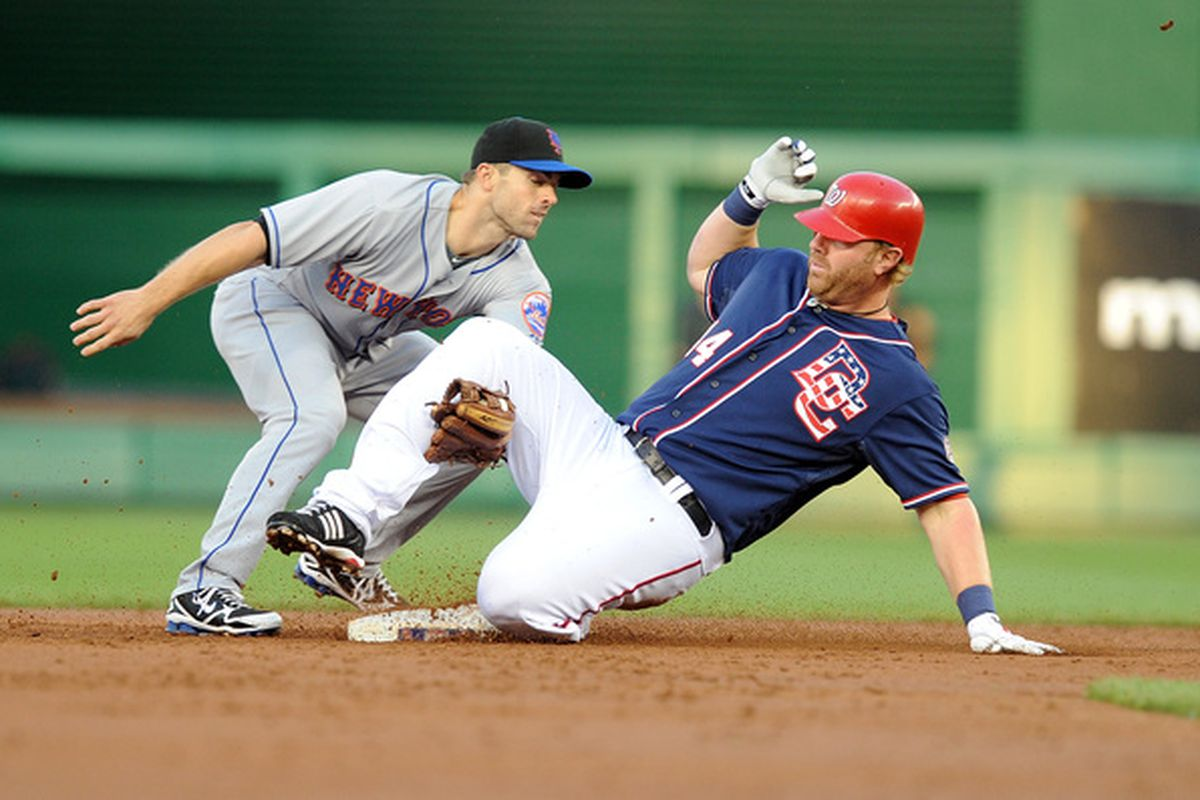 WASHINGTON - MAY 20:  Adam Dunn #44 of the Washington Nationals slides into second base for a double ahead of the tag of David Wright #5 of the New York Mets at Nationals Park on May 20, 2010 in Washington, DC.  (Photo by Greg Fiume/Getty Images)
