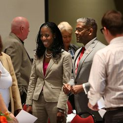 Congressional hopeful Mia Love and Former Congressman and retired Army Lt. Col. Allen chat with guests at a town hall luncheon at Salt Lake Community College's Miller Free Enterprise Conference Center in Sandy on Wednesday, Nov. 13, 2013.