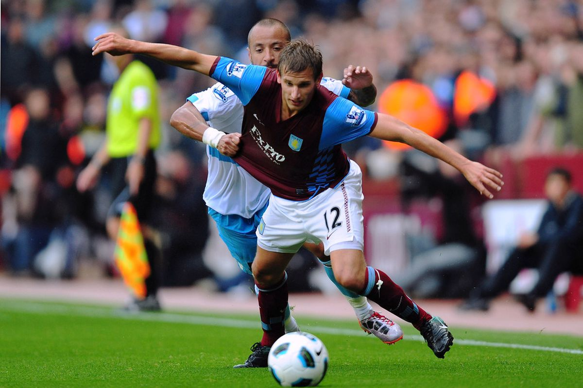 BIRMINGHAM, ENGLAND - West Ham United prove the only tactical maneuver they possess is that of pulling on shirts, as demonstrated by Julien Faubert on Marc Albrighton (Photo by Jamie McDonald/Getty Images)