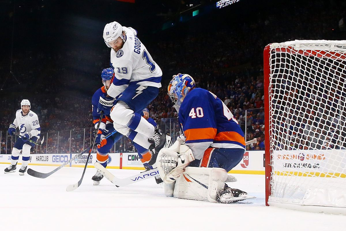 Barclay Goodrow #19 of the Tampa Bay Lightning leaps while setting a screen in front of the net against Semyon Varlamov #40 of the New York Islanders in Game Six of the Stanley Cup Semifinals of the 2021 Stanley Cup Playoffs at Nassau Coliseum on June 23, 2021 in Uniondale, New York.