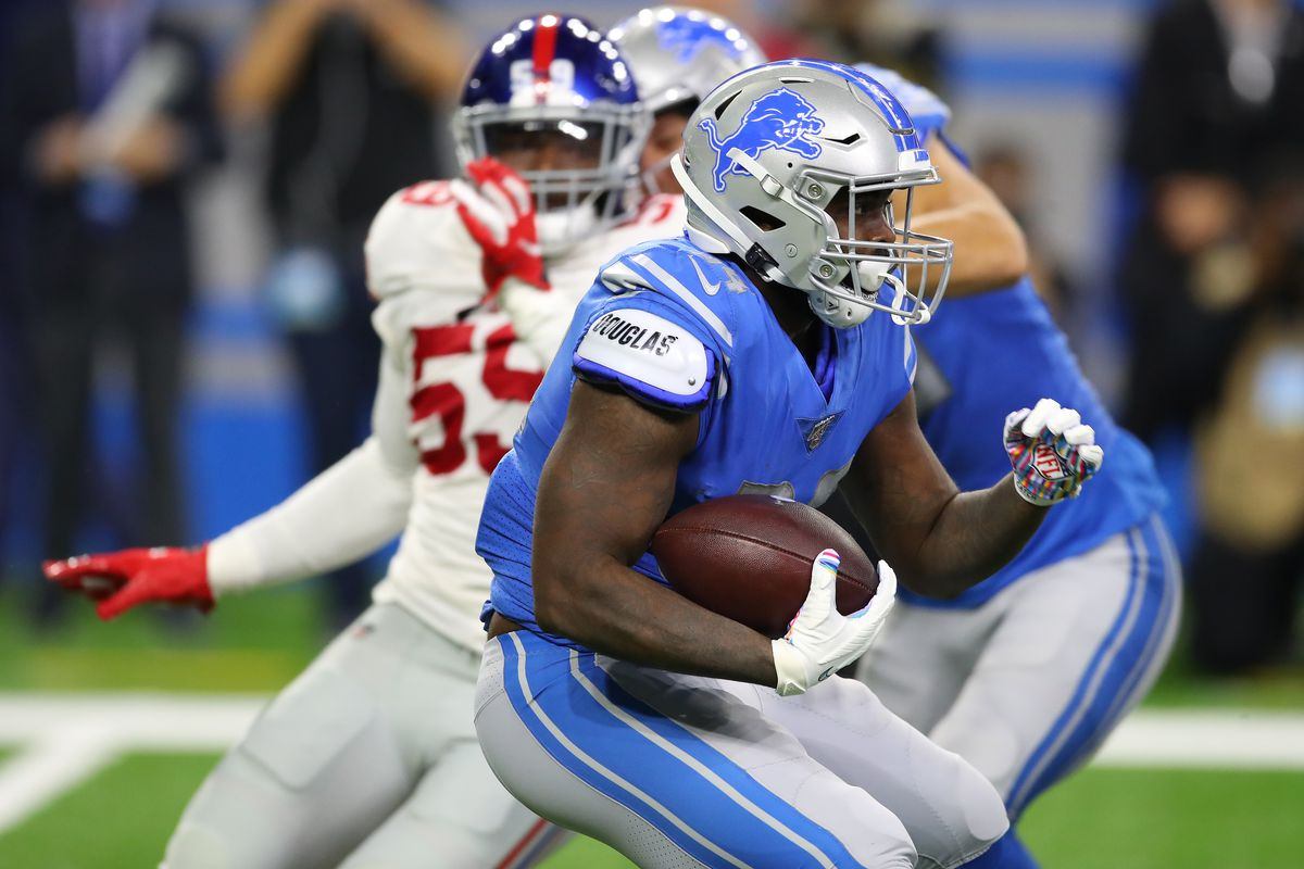 Tra Carson of the Detroit Lions looks for running room during a first half run against the New York Giants at Ford Field on October 27, 2019 in Detroit, Michigan.