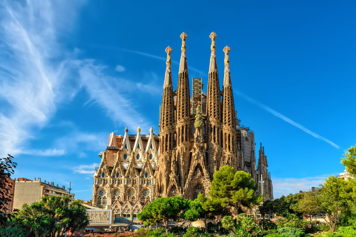 """The exterior of <span data-author=""""843"""">Sagrada Familia in Spain. The church has many tall spires and an ornately decorated facade.</span>"""