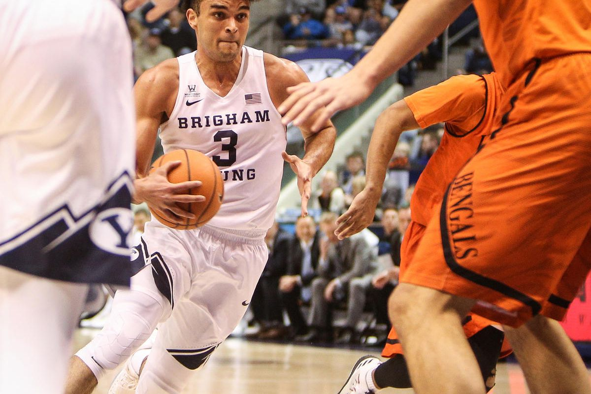 Brigham Young Cougars guard Elijah Bryant (3) drives the lane into the waiting defense of Idaho State Bengals center Novak Topalovic (13) as BYU takes on Idaho State at the Marriot Center in Provo on Thursday, Dec. 21, 2017.