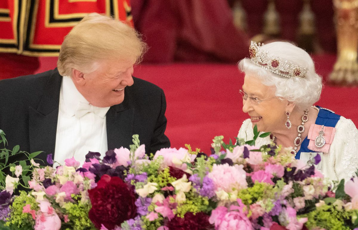 Queen Elizabeth II laughs with President Donald Trump during a state banquet in the ballroom at Buckingham Palace on June 3, 2019.