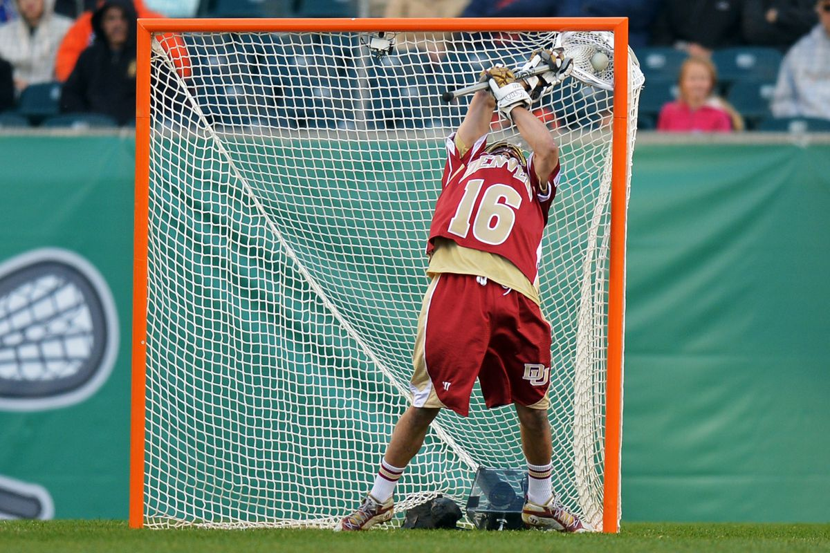 Don't let your stick go in the net with the ball like Denver's Jamie Faus did here.