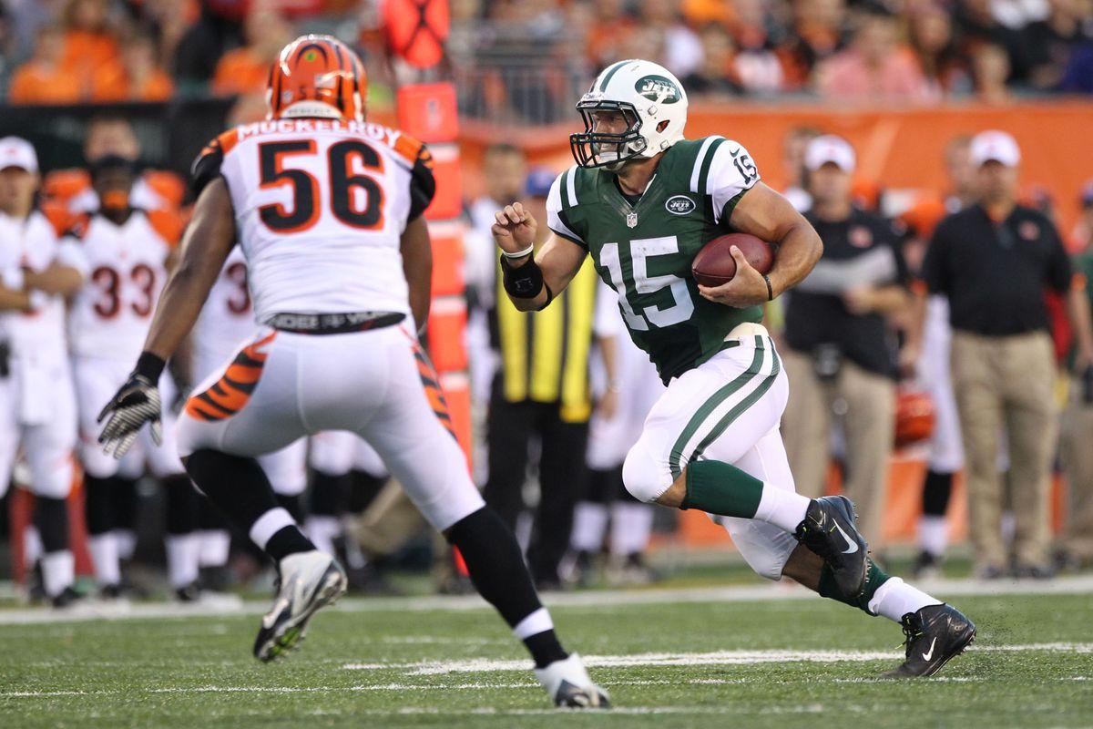 Aug 10, 2012; Cincinnati, OH, USA; New York Jets quarterback Tim Tebow (15) scrambles against Cincinnati Bengals linebacker Roddrick Muckelroy (56) at Paul Brown Stadium.  Mandatory Credit: Matthew Emmons-US PRESSWIRE