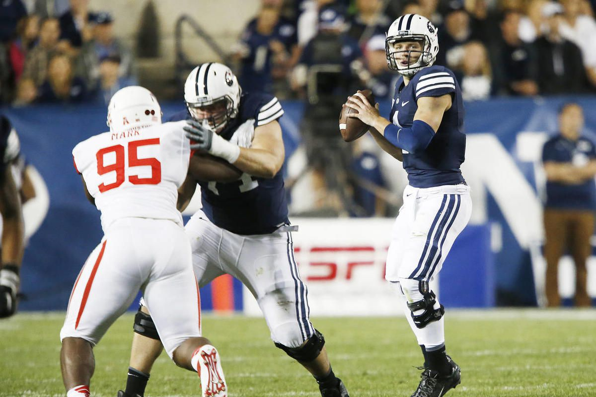 BYU quarterback Taysom Hill (4) throws against Houston in Provo on Thursday, Sept. 11, 2014. BYU and Houston announced Friday, Sept. 4, 2020, that their game scheduled for Oct. 16, 2020 has been moved from Provo to Houston.