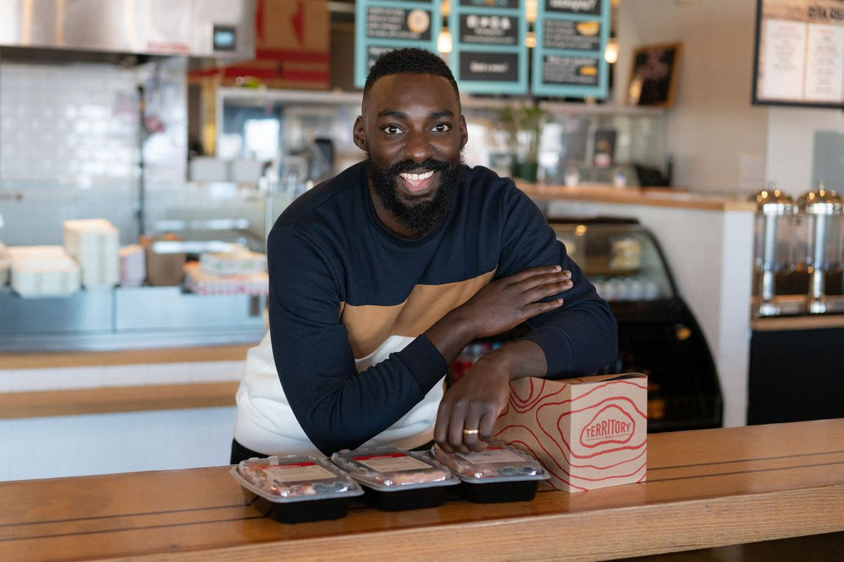 Eric Adjepong with packaged jollof rice from Territory.