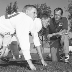 Granite High head football coach LaVell Edwards poses with players August 1960.