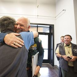 Charles W. Dahlquist II, national commissioner of the Boy Scouts of America, hugs Tim Fenton at a dedication ceremony for the Thomas S. Monson Lodge at the Hinckley Scout Ranch in the Uinta Mountains on Wednesday, Oct. 5, 2016. President Henry B. Eyring, first counselor in the First Presidency of the Church of Jesus Christ of Latter-day Saints, dedicated the facility.