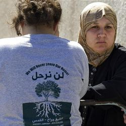 Palestinian Maisus Al-Ghawy, right, is seen after being evicted from her house in the East Jerusalem neighborhood of Sheikh Jarrah Sunday.