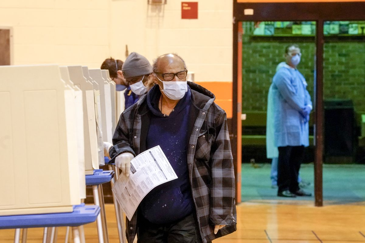 People vote at Riverside High School for Wisconsin's primary election Tuesday in Milwaukee.